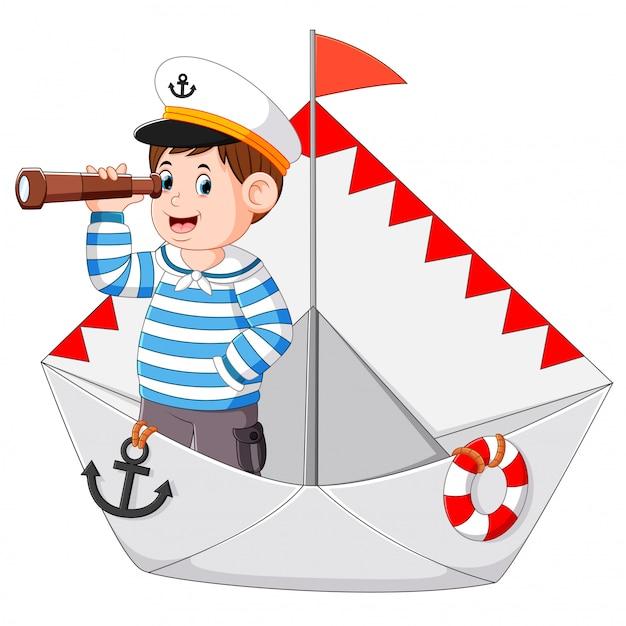 Le marin tient les jumelles dans le papier du bateau Vecteur Premium