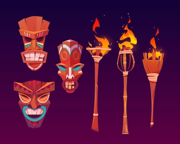 Masques Tiki Et Torches Enflammées, Totems Tribaux En Bois, Attributs Hawaïens Ou Polynésiens Vecteur gratuit