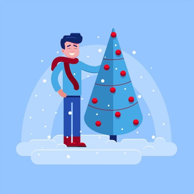 Mec souriant montrant l'arbre décoré Vecteur Premium