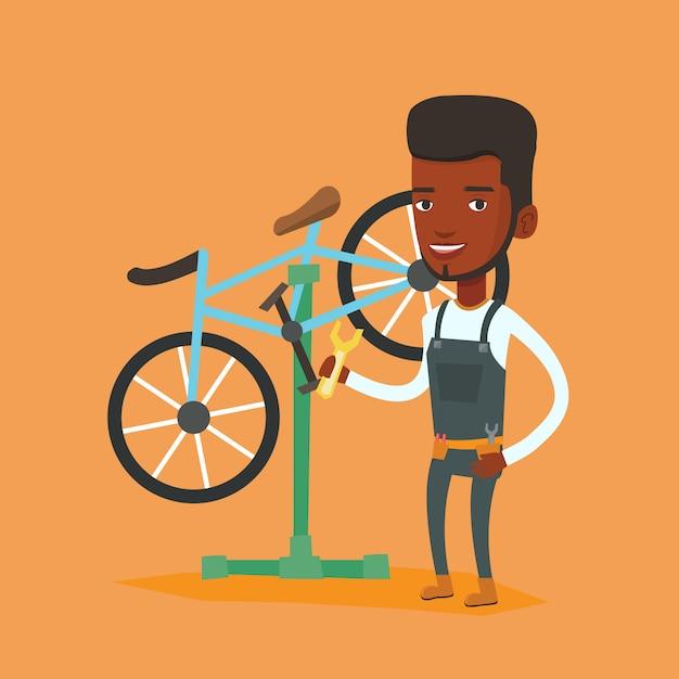 Mécanicien De Vélo Africain Travaillant Dans Un Atelier De Réparation. Vecteur Premium