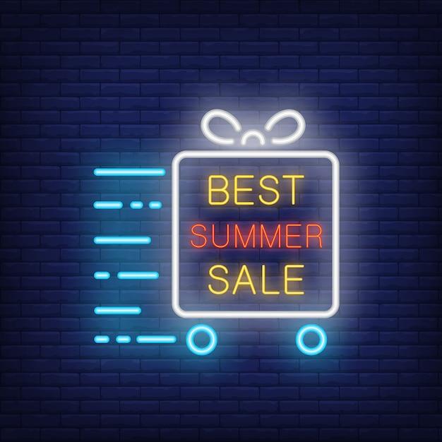 Meilleure enseigne au néon d'été texte brillant dans le cadre, boîte-cadeau sur roues en mouvement. annonce lumineuse de nuit Vecteur gratuit