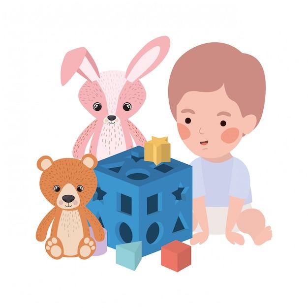 Mignon petit bébé garçon jouant avec le personnage de jouets Vecteur Premium