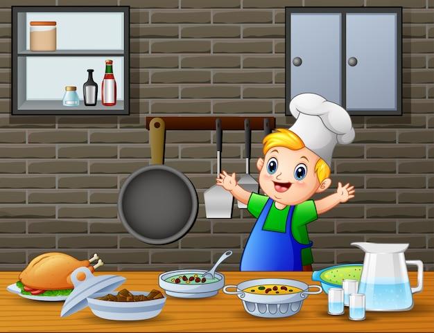 Mignon petit garçon en tablier et une toque prépare des plats Vecteur Premium