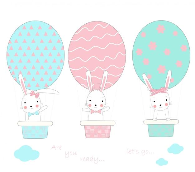 Le mignon petit lapin avec un ballon en forme d'oeuf Vecteur Premium