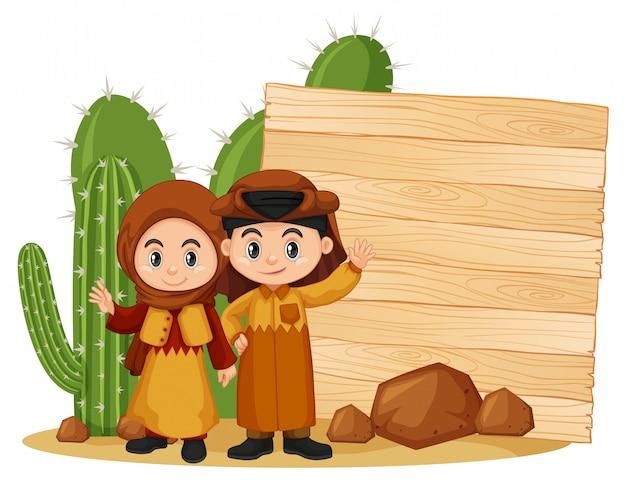Modèle de cadre avec enfant heureux et cactus Vecteur Premium