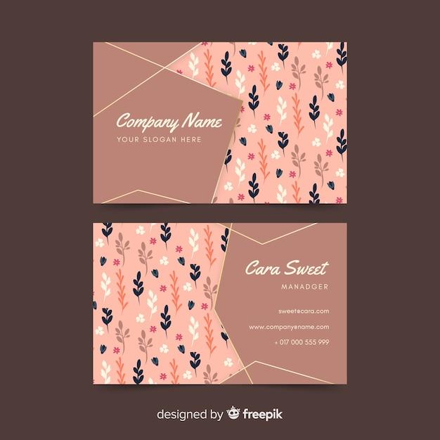 Modèle de carte de visite floral avec des accents dorés Vecteur gratuit