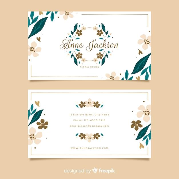 Modèle de carte de visite floral avec des lignes d'or Vecteur gratuit