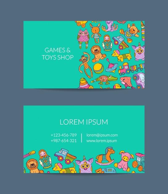 Modèle de carte de visite pour boutique, jardin d'enfants avec des éléments de jouets d'enfant dessinés à la main Vecteur Premium