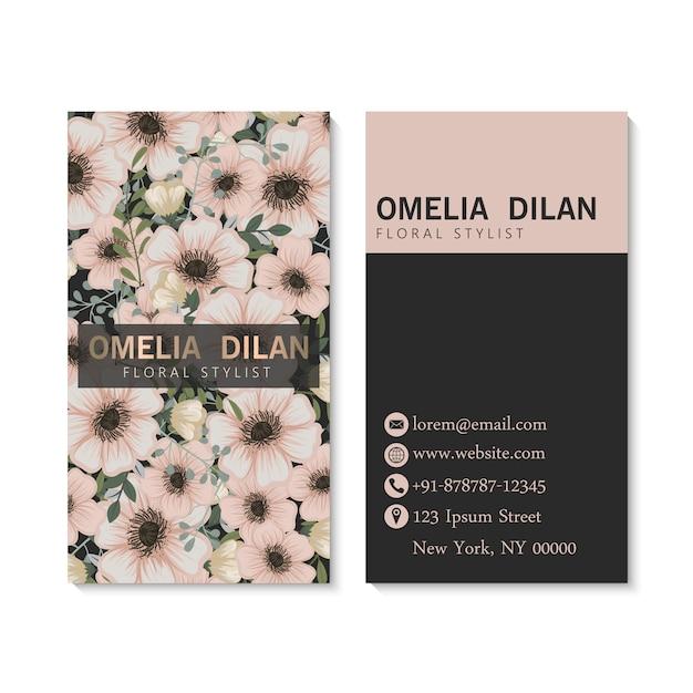 Modèle de carte de visite sombre de luxe avec des fleurs. Vecteur gratuit