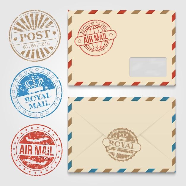 Modèle d'enveloppes vintage avec des timbres postaux grunge Vecteur Premium