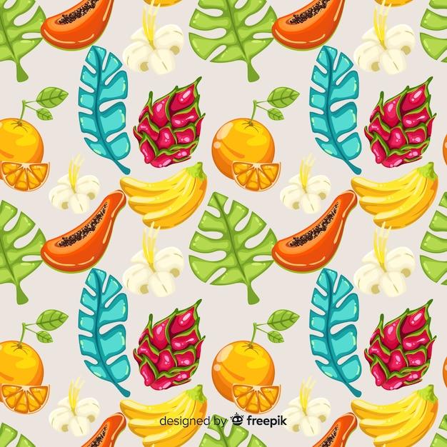 Modèle de feuilles et de fruits tropicaux dessinés à la main Vecteur gratuit