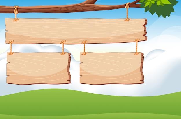 Modèle De Panneau En Bois Sur La Branche Avec Fond De Ciel Vecteur gratuit