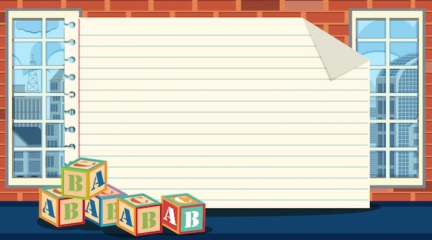 Modèle De Papier Avec Des Blocs D'alphabet Sur Le Sol Vecteur Premium