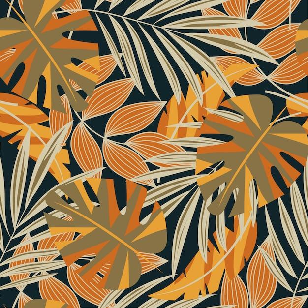 Modèle sans couture abstrait original avec des feuilles tropicales colorées et des plantes sur un fond sombre Vecteur Premium
