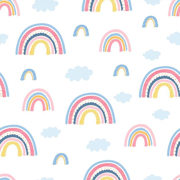 Modèle sans couture avec arc-en-ciel, nuages et lettres de la main se concentrent sur le bien pour les enfants Vecteur Premium