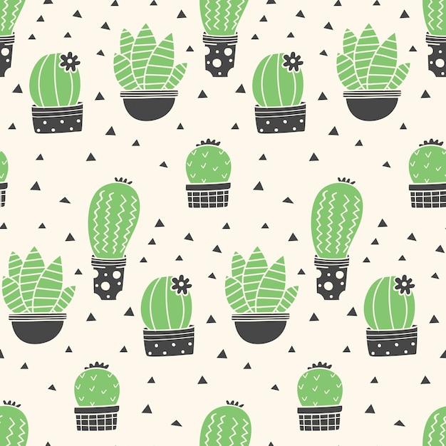 Modèle sans couture de cactus dessinés à la main Vecteur Premium