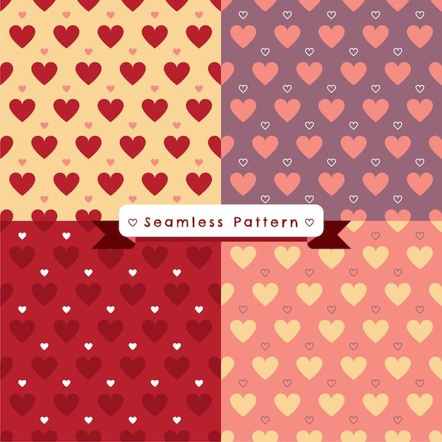 Modèle sans couture de coeurs sur backgronds 4 couleurs Vecteur Premium