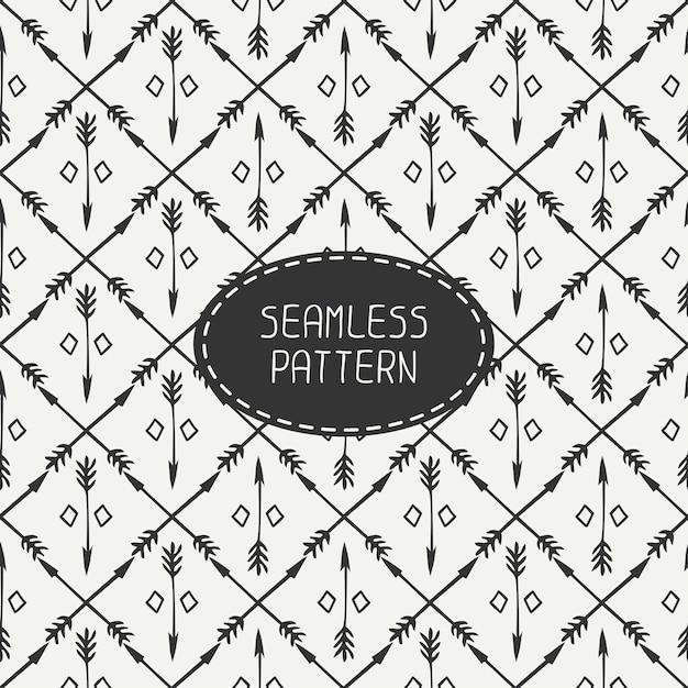 Modèle sans couture ethnique avec des flèches. doodles dessinés à la main Vecteur Premium
