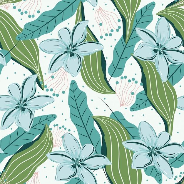 Modèle sans couture avec des feuilles tropicales et des fleurs délicates Vecteur Premium