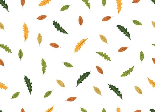 Modèle sans couture de feuilles tropicales sur fond blanc. Vecteur Premium