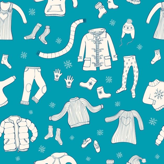 Modèle sans couture avec motif de vêtements d'hiver. Vecteur Premium