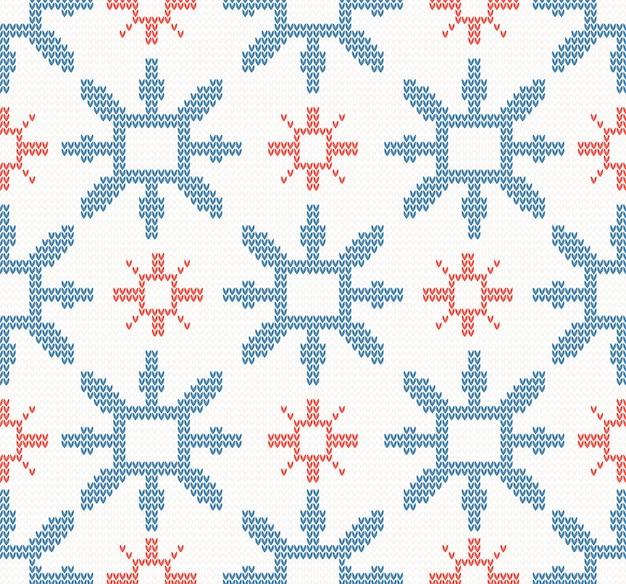 Modèle sans couture de noël avec des flocons de neige bleus et rouges Vecteur Premium