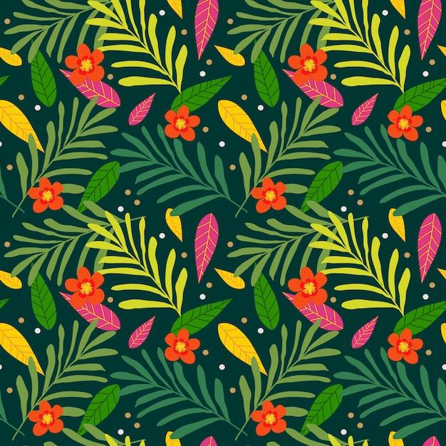 Modèle sans couture tropical exotique avec des feuilles de palmier et des fleurs colorées. Vecteur Premium
