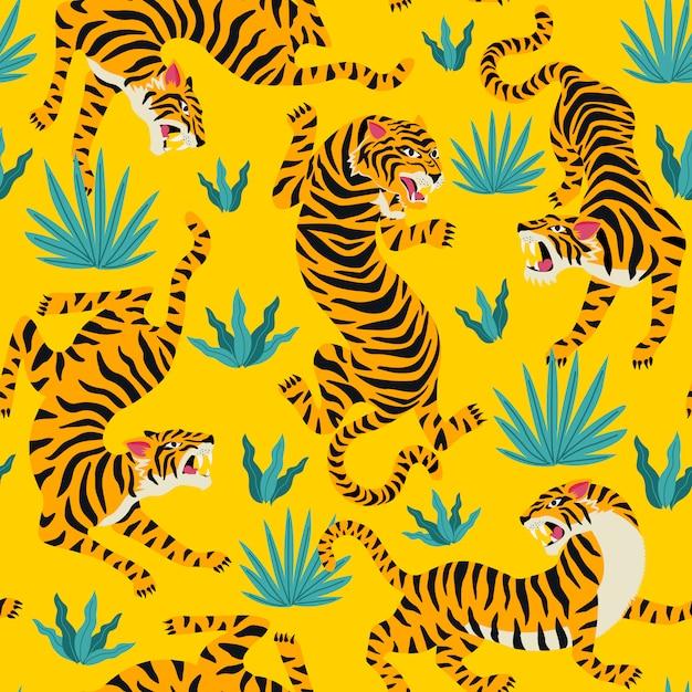 Modèle sans couture de vecteur avec des tigres mignons sur le fond. Vecteur Premium