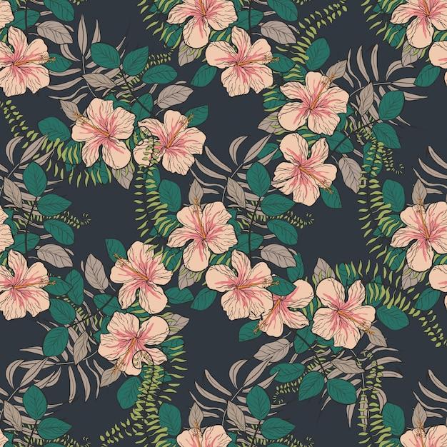 Modèle tropical avec des fleurs et des feuilles d'hibiscus. Vecteur Premium