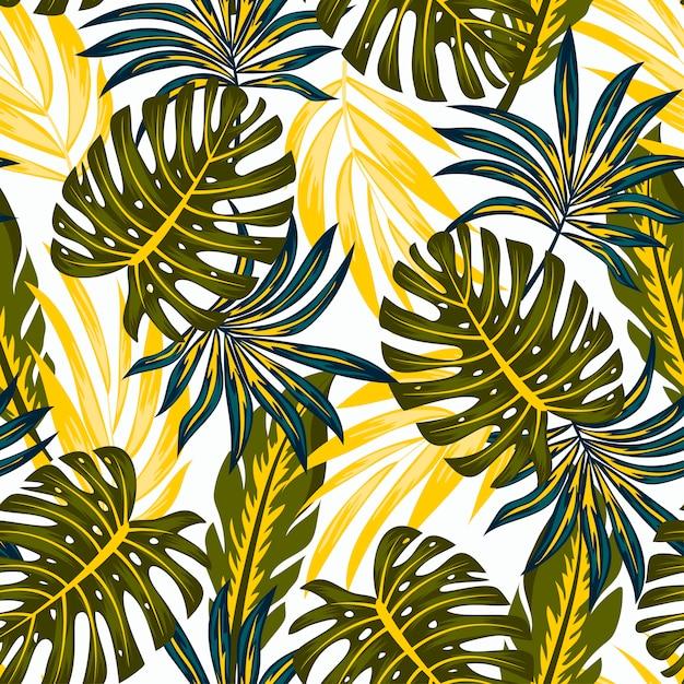 Modèle Tropical Sans Couture Original Avec Des Plantes Et Des Feuilles Lumineuses Sur Fond Blanc Vecteur Premium