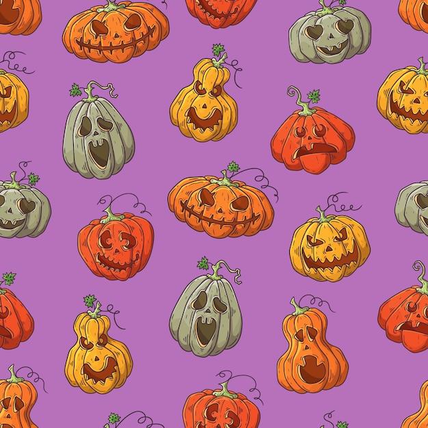 Modèle vectoriel dessiné avec des citrouilles d'halloween à la main. Vecteur Premium