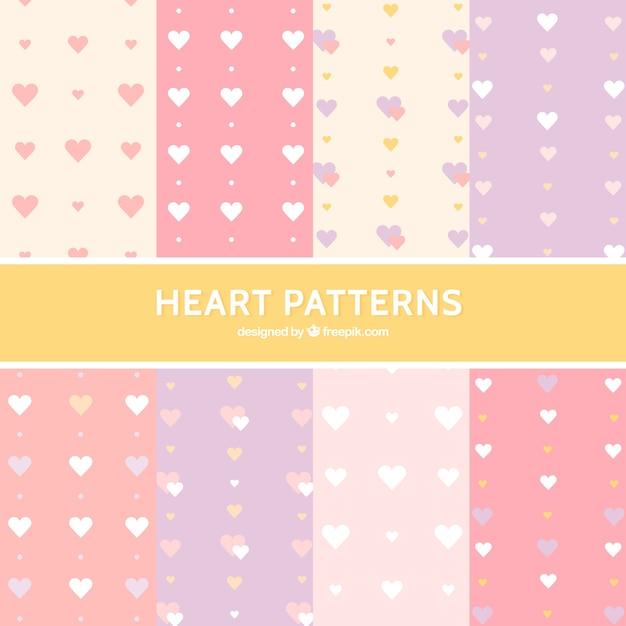 Modèles de coeurs en couleur pastel Vecteur gratuit