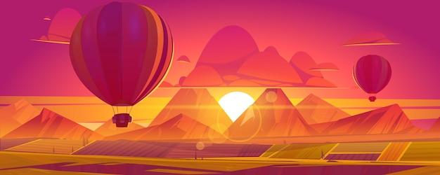 Montgolfières Volant Au-dessus Des Champs, Des Montagnes Dans Le Ciel De Couleur Rouge Et Orange Au Coucher Du Soleil Ou Au Lever Du Soleil Paysage Paysage Vecteur gratuit