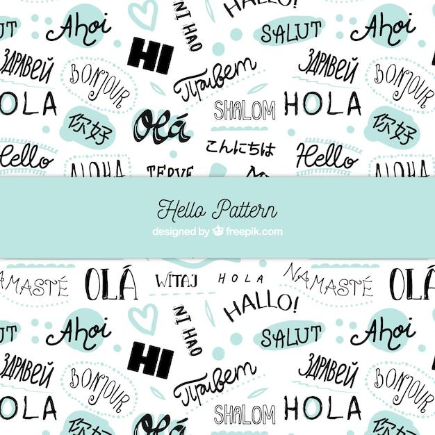 Mot de mot bonjour dessiné à la main dans différentes langues Vecteur gratuit