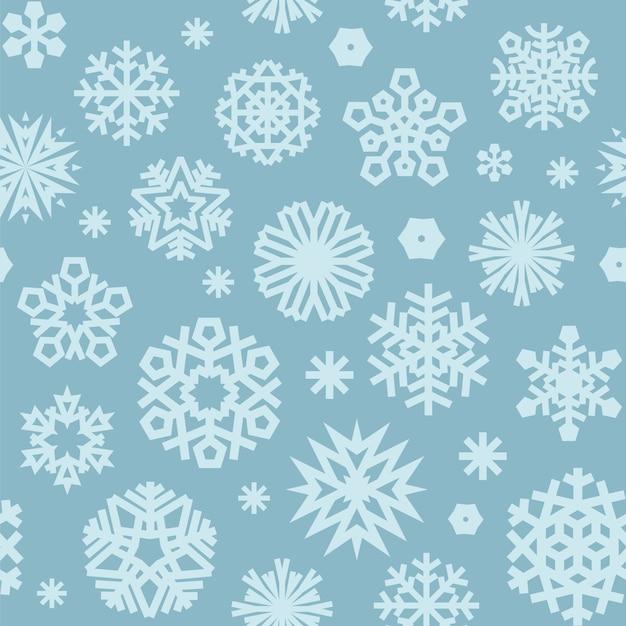 Motif bleu sans couture de noël avec des flocons de neige Vecteur Premium