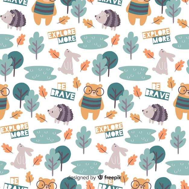 Motif coloré d'animaux et de mots de la forêt doodle Vecteur gratuit
