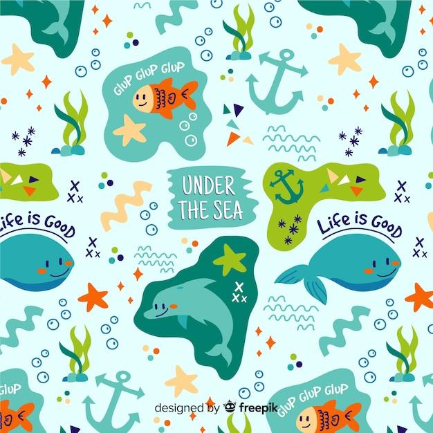 Motif coloré d'animaux et de mots de mer doodle Vecteur gratuit