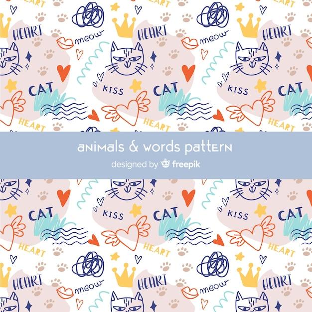 Motif coloré de chats et mots doodle Vecteur gratuit
