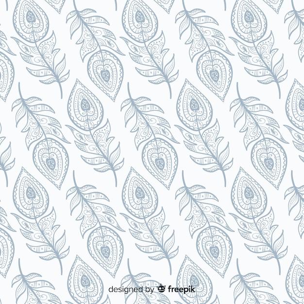 Motif décoratif en plumes de paon Vecteur gratuit