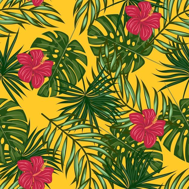 Motif feuilles et fleurs tropicales Vecteur Premium