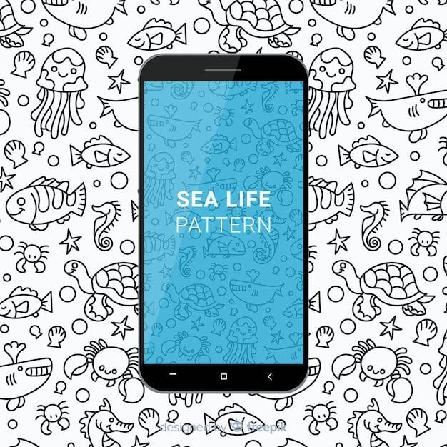 Motif mobile de la vie de mer dessiné main Vecteur gratuit