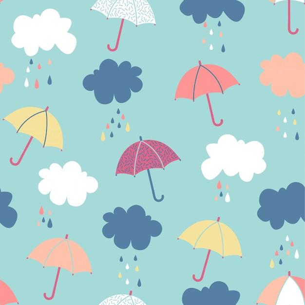 Motif de nuage et parapluie sans couture Vecteur Premium