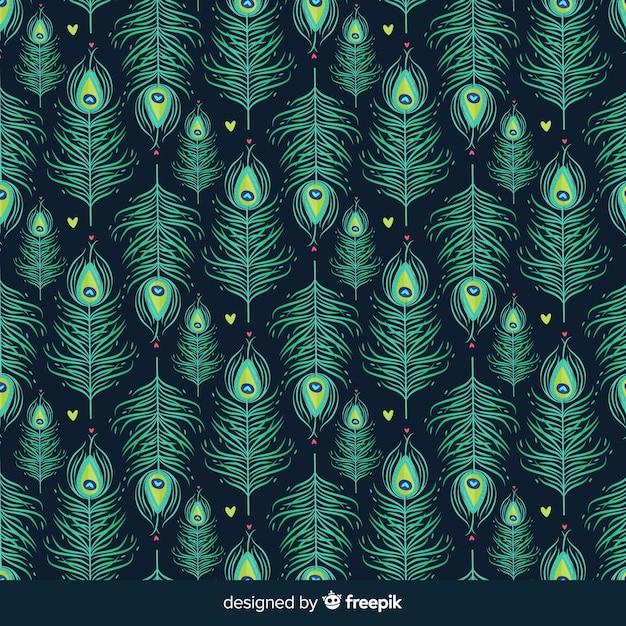 Motif de plumes de paon dessiné main belle Vecteur gratuit