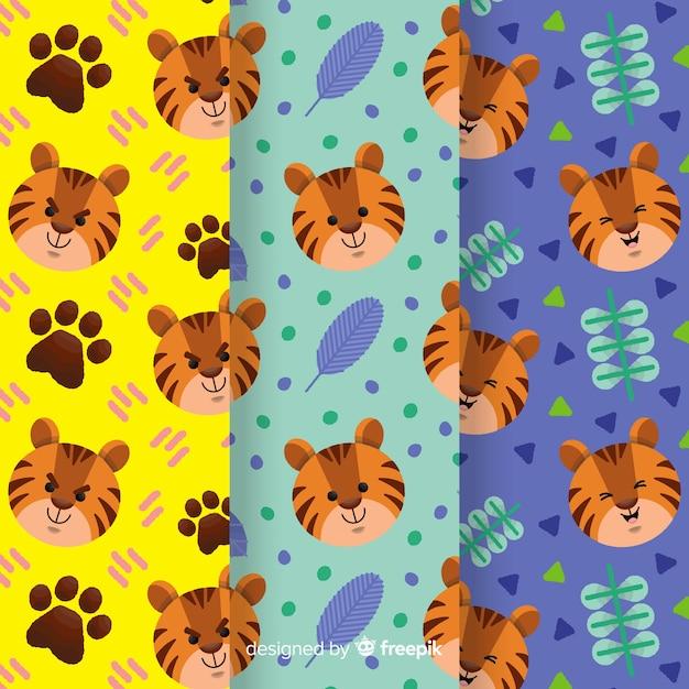 Motif de tigre dessiné à la main créative Vecteur gratuit