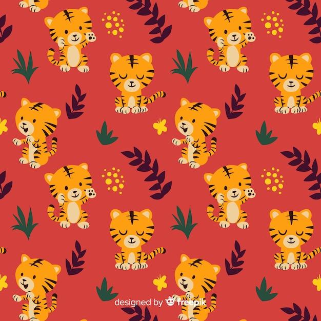 Motif de tigre dessiné à la main Vecteur gratuit