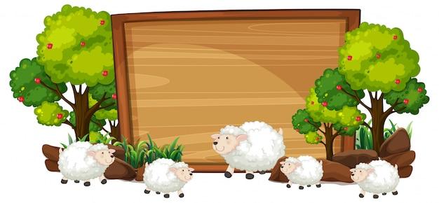 Moutons sur la bannière en bois Vecteur Premium