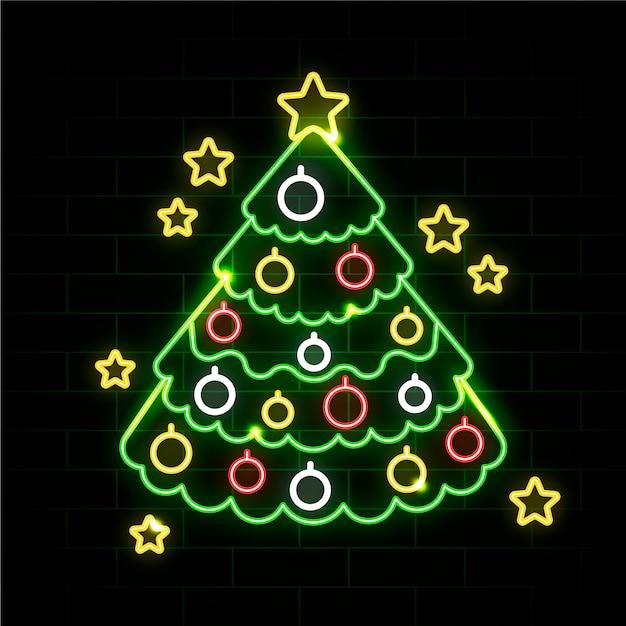 Néon Arbre De Noël Sur Un Mur De Briques Vecteur gratuit