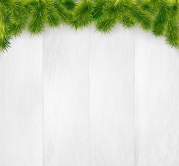 Noël en bois avec des branches de sapin Vecteur Premium