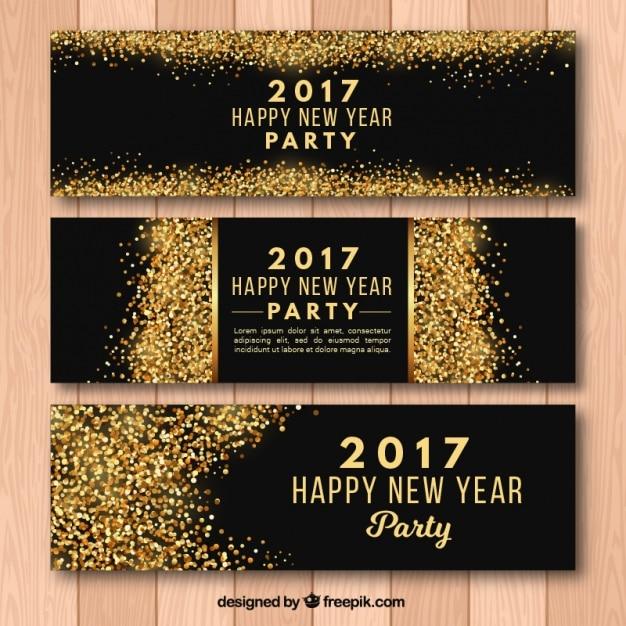 Nouvel an 2017 des bannières avec des paillettes d'or Vecteur gratuit