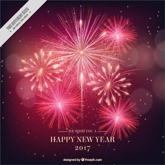Nouvel an 2017 feux d'artifice lumineux fond Vecteur gratuit